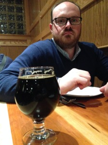 Admiring the brew.