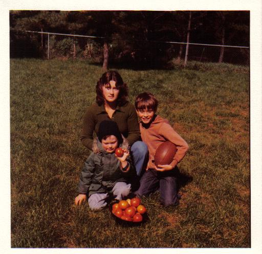 mom, chris and john henry with tomatoes